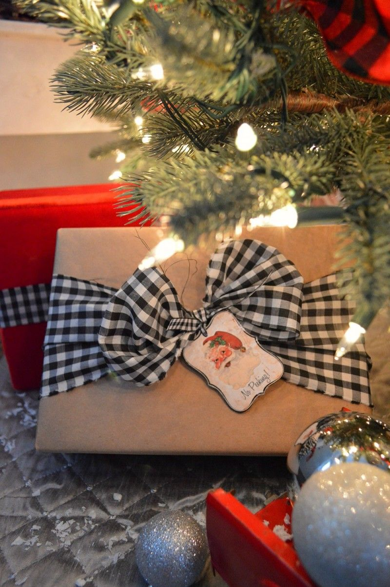 Budget Christmas Present Wrapping Idea Dollar Tree Brown Paper With Black White Checked Bow Its Fabric Cut In Strips And Vintage Santa Gift Tags From