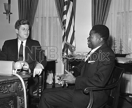 1961. 22 Mars. President John Kennedy talks in his White House office in Washington with Joseph Ngous, newly-appointed ambassador of the Republican of Gabon, one of the new African nations. Ngous told the President that troubles in the Congo should be left to the Congolese for solution. The ambassador called on Kennedy to present his credentials (AP Photo)