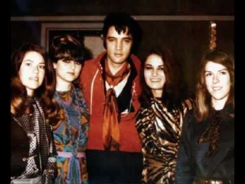 "Pictured here with Elvis are the American Sound Studio's backup singers known as "" The Ladies. "" Among the songs they sang back up on were, In The Ghetto , Suspicious Minds , and Kentucky Rain. They would go on to record with Elvis many times until his passing in 1977."