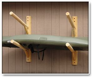 Two Place Wall Mounted Log Kayak Rack Outside Of The Guest House?