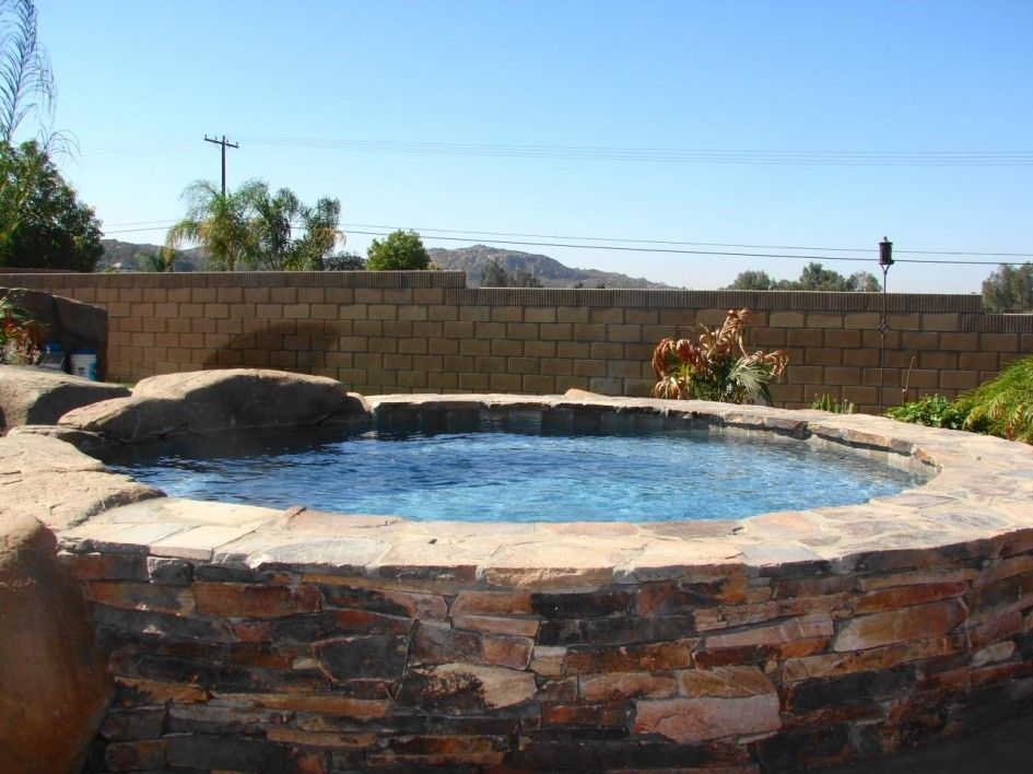 Above ground pool with stone surround pool tile for Above ground pool decks with hot tub