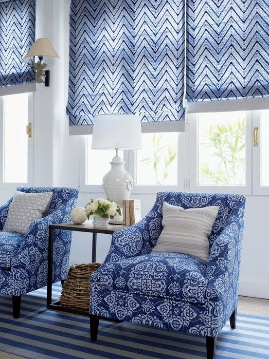 Beautiful Roman shades in blue and white with coordinating chairs.