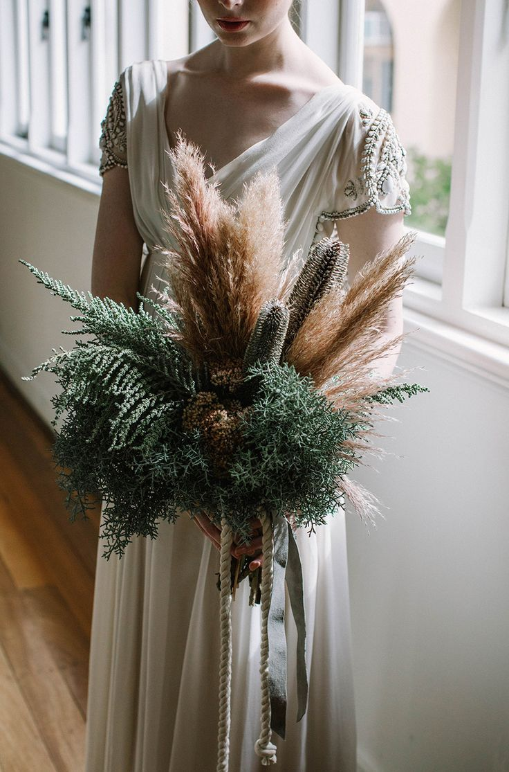 Pampas wedding bouquet alternative wedding bouquet ideas unique who knew dried foliage could be so cool wheat pampas grass and dried flowers are perfect for a christmas free winter themed wedding izmirmasajfo Choice Image