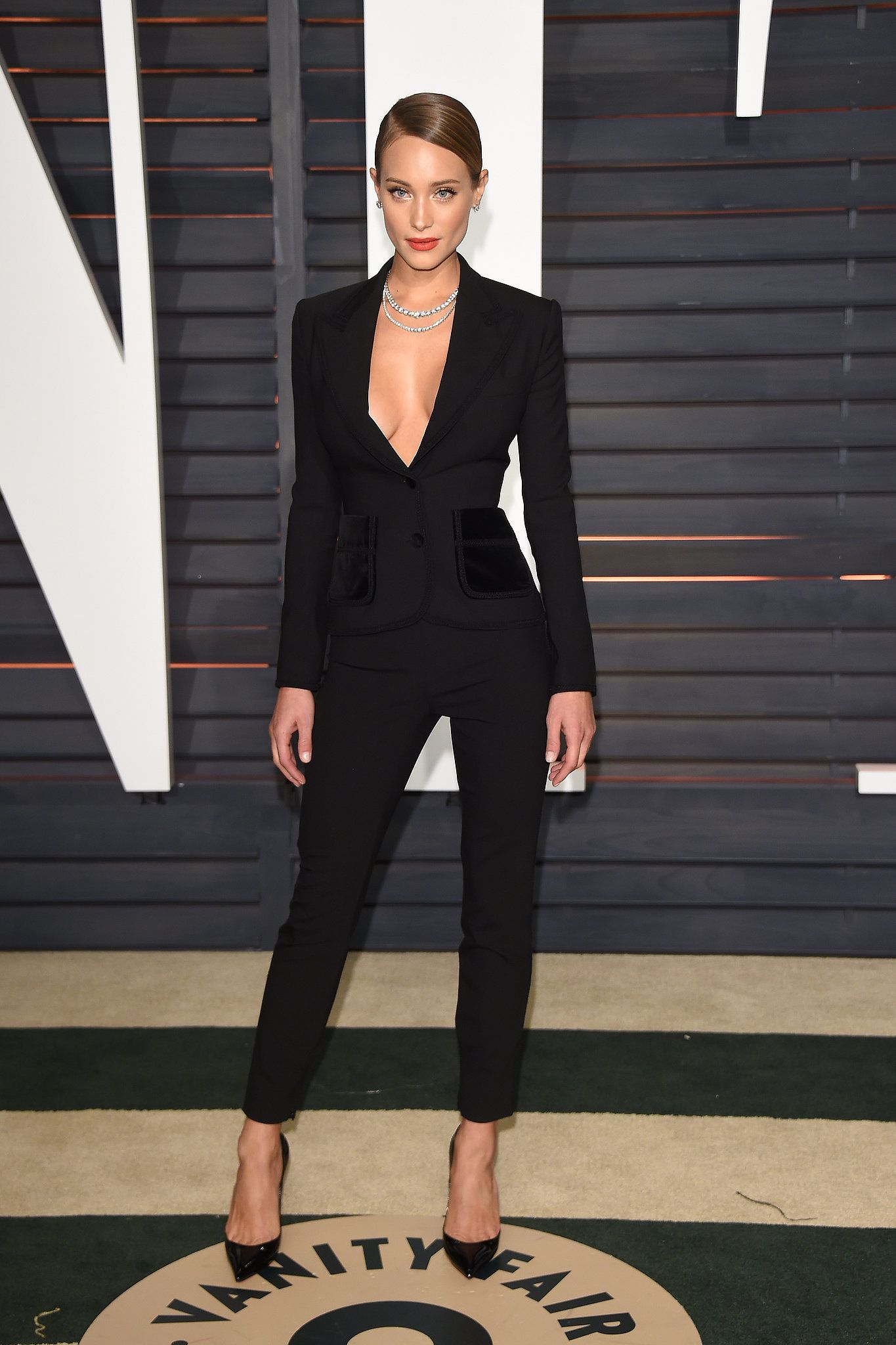 47972351de5ed6 At the Vanity Fair party, the supermodel worked a suit the ultrasexy way   tight tailoring, black pumps, and a deep plunging neckline.