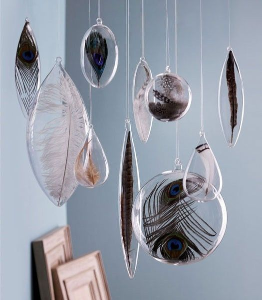 floating glass feathers. by kathryn