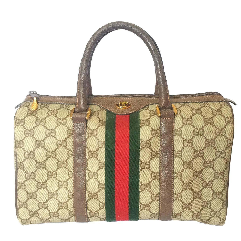ea2d713bd 80's vintage Gucci brown monogram webbing sherry line speedy style handbag.