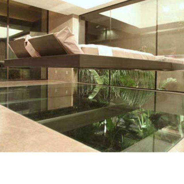 Bed Hanging Above Water
