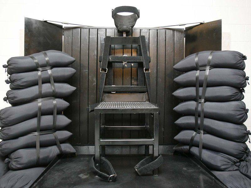"""[""""Utah Brings Back Firing Squad Executions; Witnesses Recall The Last One""""] [""""The firing squad execution chamber at the Utah State Prison in Draper, Utah, is shown in June 2010.""""]"""