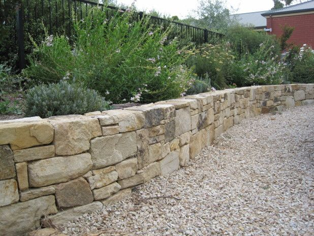 Exterior. Simple And Neat Natural Stone Retaining Garden Wall