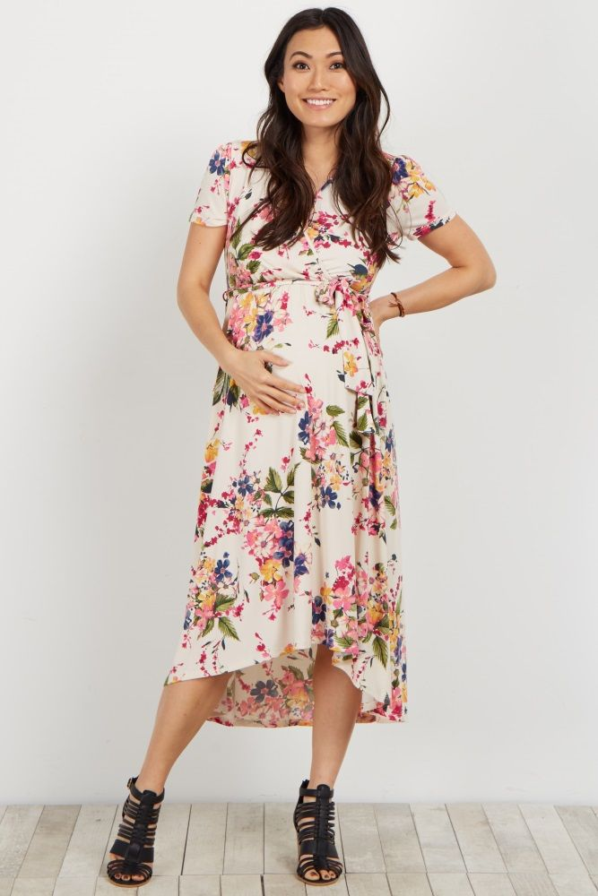 17fe58117448d Florals are a staple for this season and this maternity wrap dress is a  necessity. This dress features a trendy hi-low hemline and a wrap style  that is ...