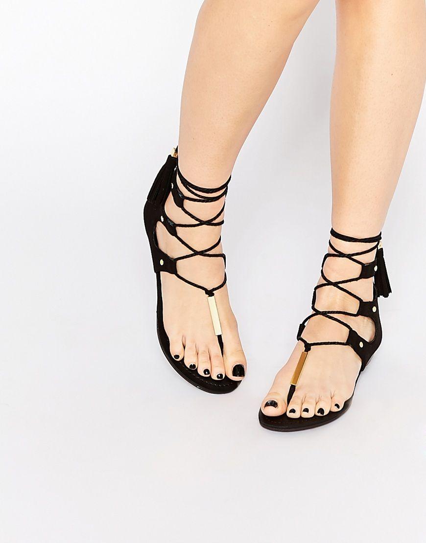 Black sandals ultima online - Image 1 Of Aldo Jakki Black Gladiator Tassel Flat Sandals