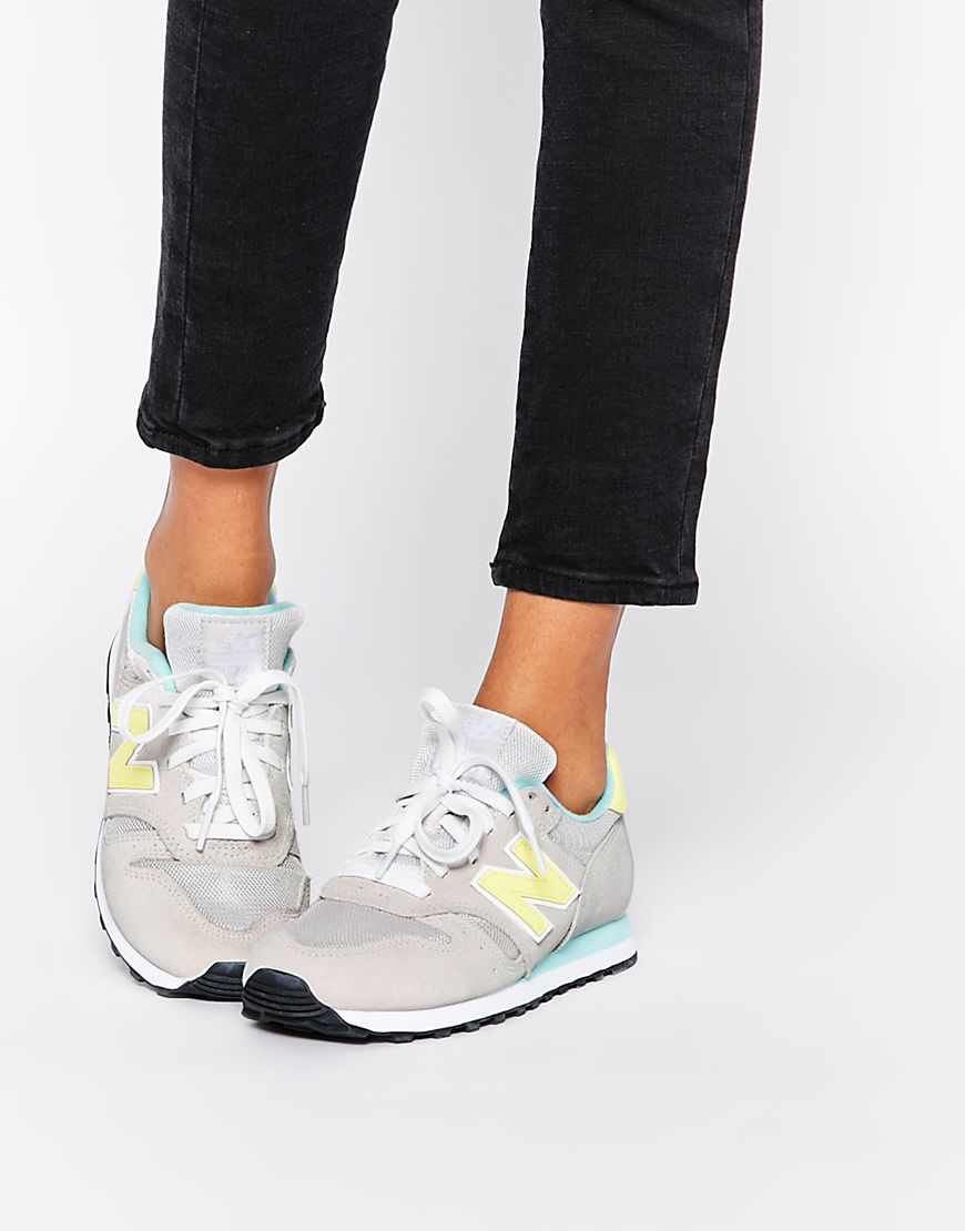 New Balance Suede Off White & Yellow 373 Trainers at asos.com ...