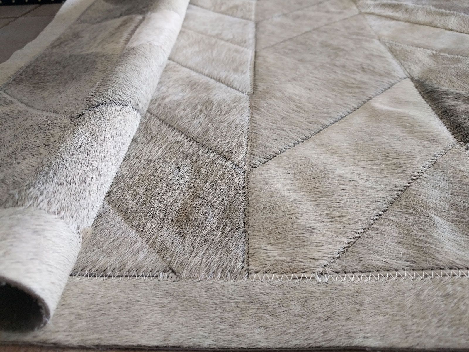 Add A Touch Of Elegance To Your Home With Our Gray Patchwork Cowhide Rug Classic Chevron Design In 2020