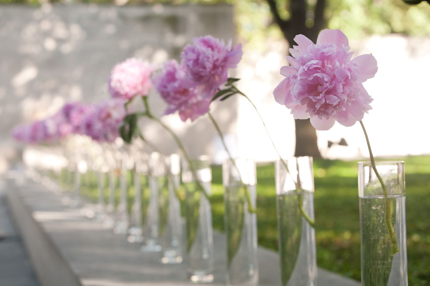Wedding decoration ideas simple  Simple pink flowers in vases Photo by Scott Hagar Photography