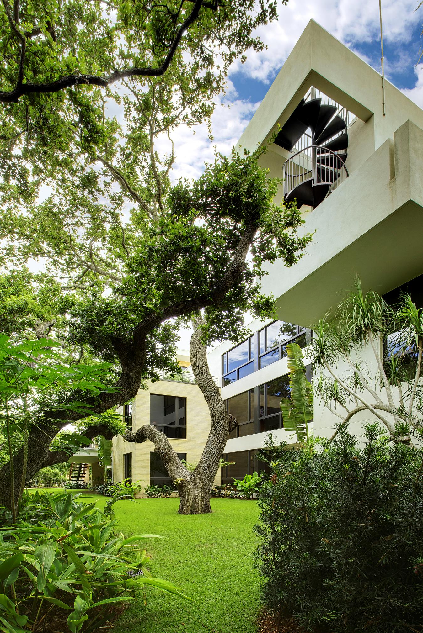 Rear elevation (1 of 2) of the winner of a 2010 BALA award for Custom Home 4000-6500 sq.ft.  Architect: Totems Architecture.  Builder: Michael K. Walker & Associates.  Interior Designer: Studio Hive. Photographer: Greg Wilson Photography.