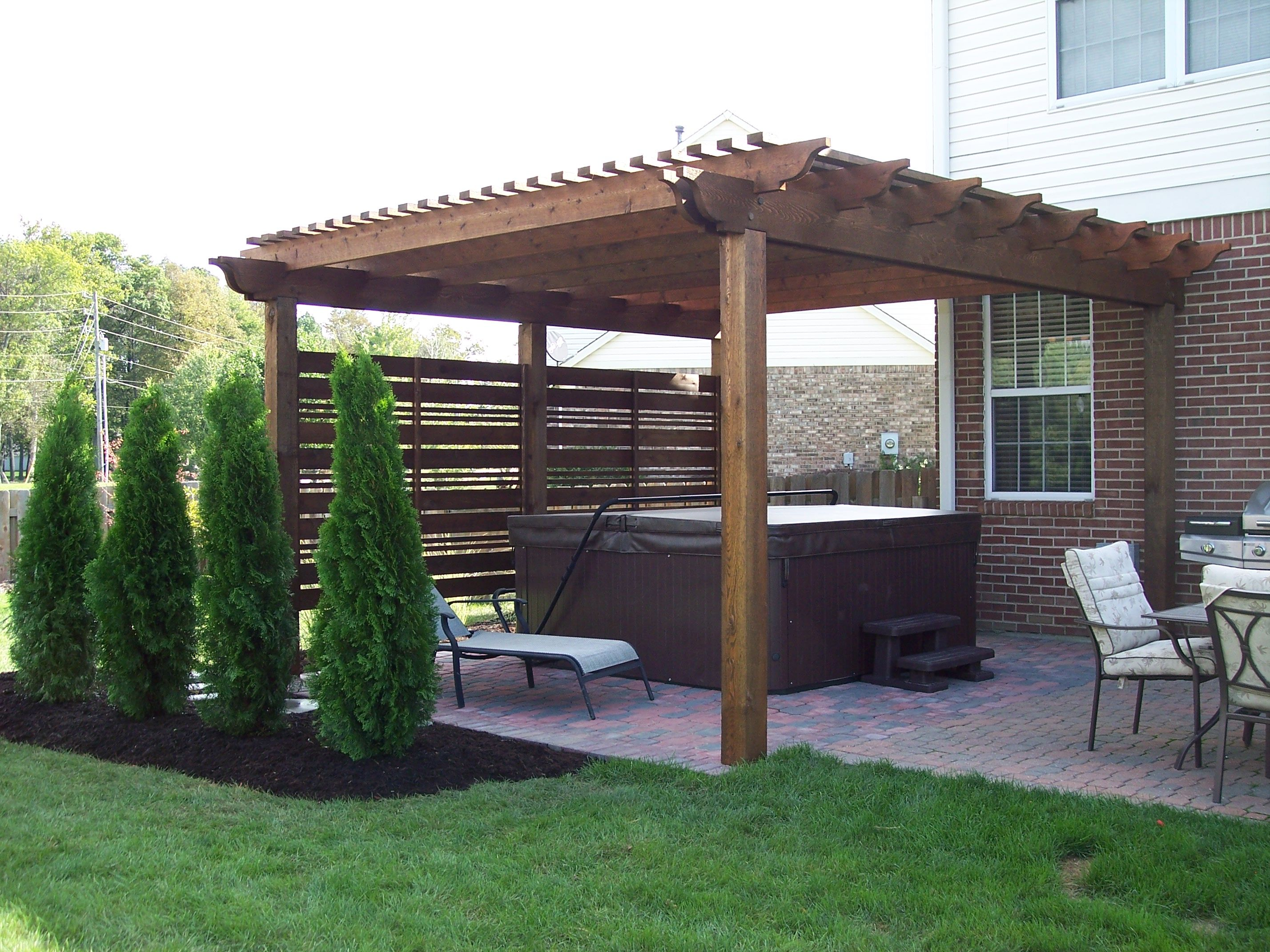 pergola and screening provide a hot tub oasis