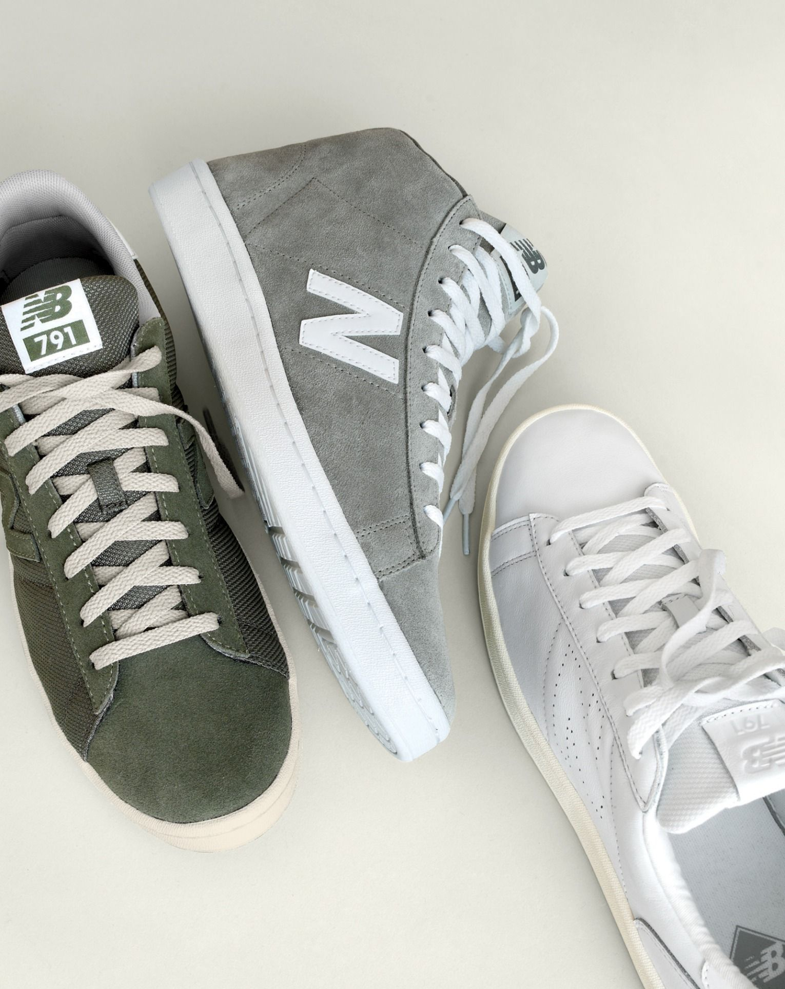 Take your kicks to work day. Dressing up doesn't always mean dress shoes. J.Crew's latest exclusive New Balance® sneakers can be a streamlined substitute for your wing tips. To pre-order, call 800 261 7422 or email verypersonalstylist@jcrew.com.