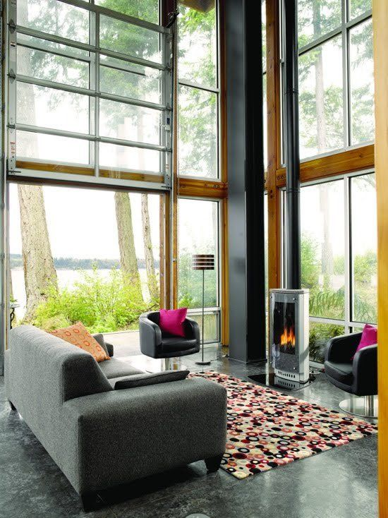 roll up door to make open air living room looking out over a lake ...