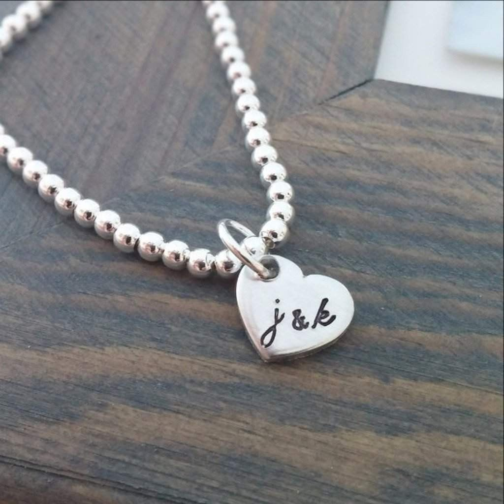 Personalized bracelet with hand stamped initials products