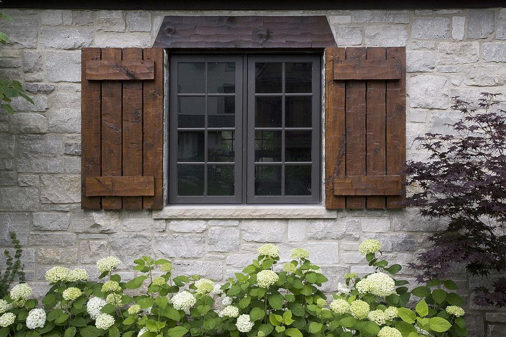 Cedar Shutters Exterior Traditional With Black Clad Windows Hand Hewn Shutters Stone Shutters Exterior House Shutters Windows Exterior