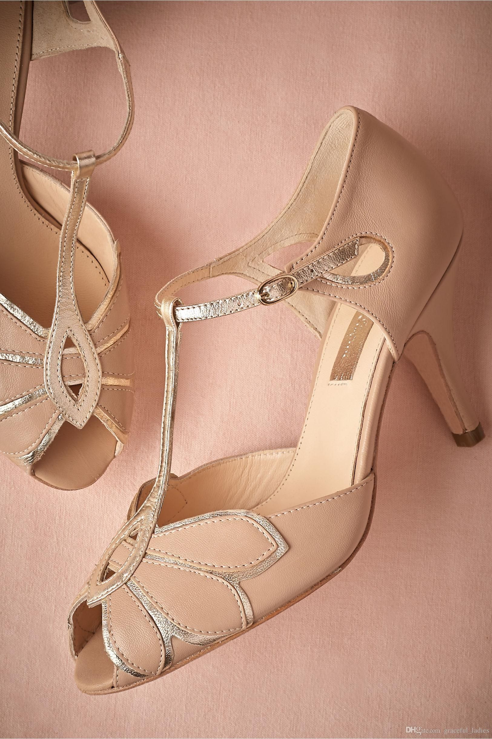 Blush pink vintage wedding shoes with a low heel and t-bar strap.