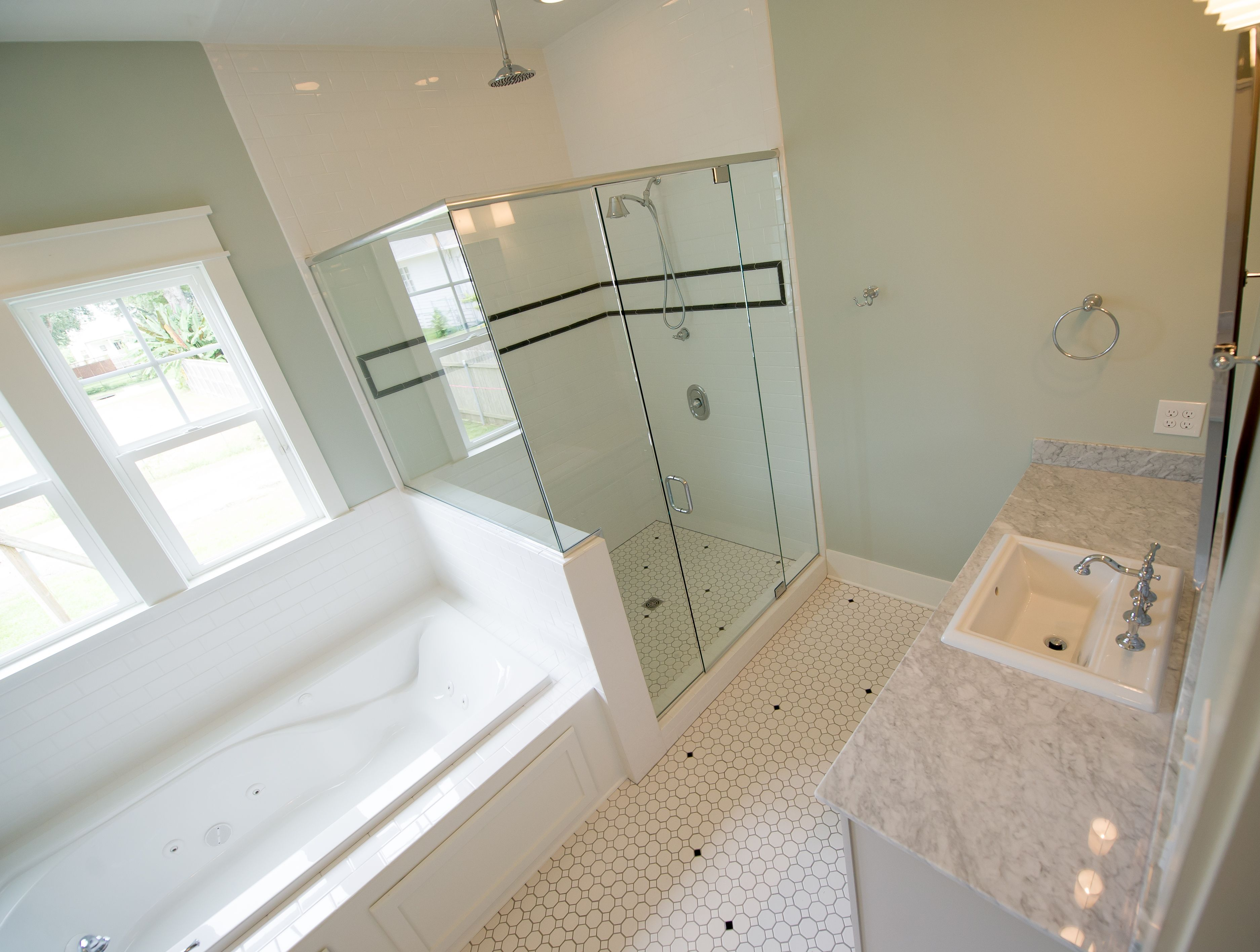 Master bathroom suite with subway tile shower jacuzzi tub marble master bathroom suite with subway tile shower jacuzzi tub marble countertops and ceramic mosaic dailygadgetfo Images