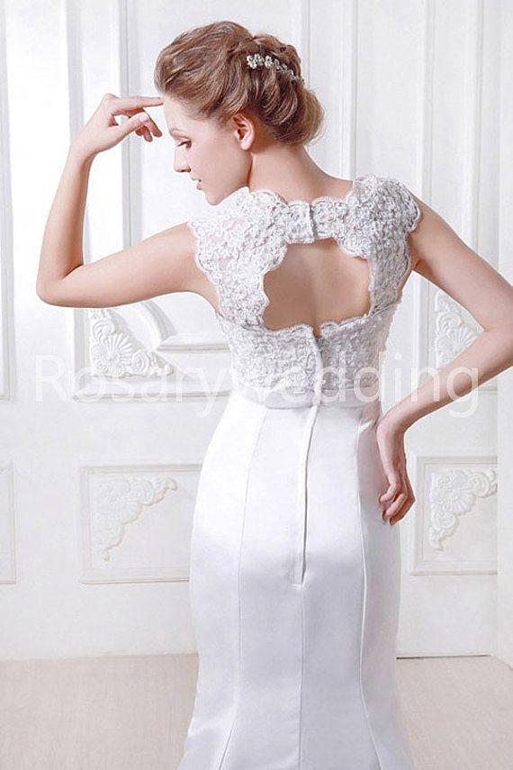 Lace shoulder straps open back satin lace wedding dress. $268.00, via Etsy.