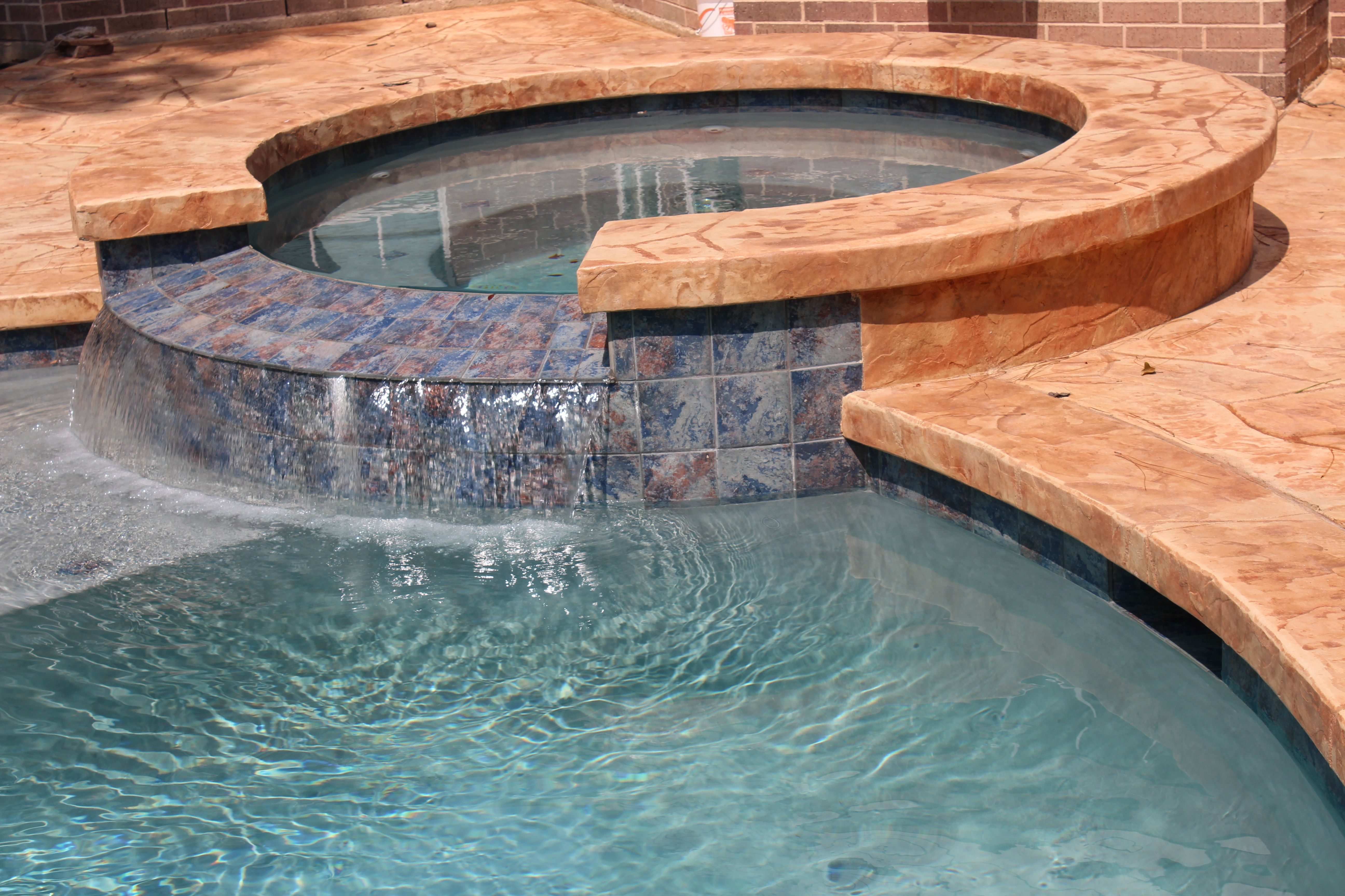 Swimming Pool Round Spa With Tile Spillway Stamped Concrete Deck With Stamped Concrete Cantilever Coping Swimming Pools Backyard Pool Designs Pool Remodel