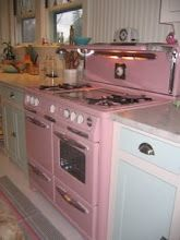 cute antique stove-I love the pink!