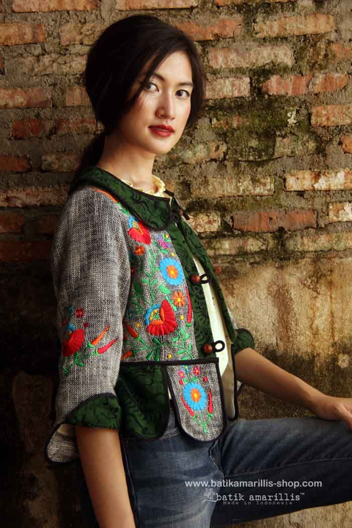 batik amarillis's piccola vest /jacket Piccola jacket in lovely grey -black  woven cotton  vest with  multi colored Hungarian folk embroidery meets tenun batik  gedog Tuban,Indonesia Take a fresh, sweet & whimsical approach to power dressing with this Krakow-Poland classic traditional folklore inspired jacket.  The beauty essential is reworked with a contrast-coloured batiks,unique cuttings ,trims,glossy beaded buttons,it has fitted waist with unique peplum petals