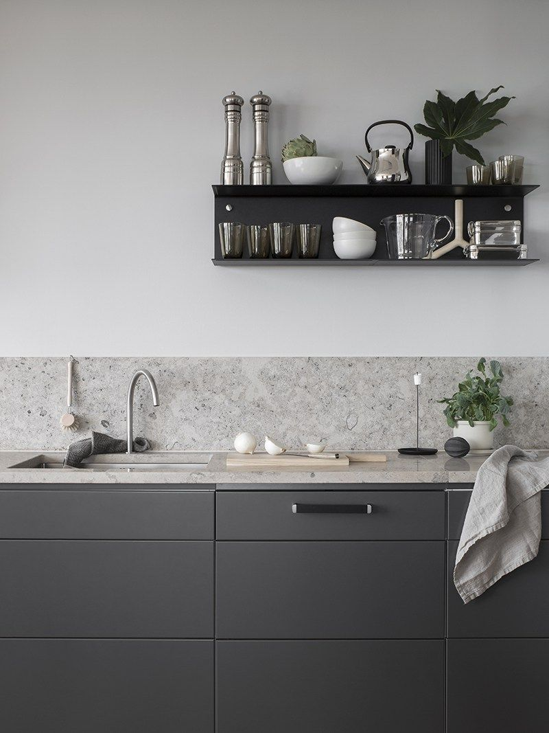 Dark grey kitchen with a natural stone top   via Coco Lapine ...