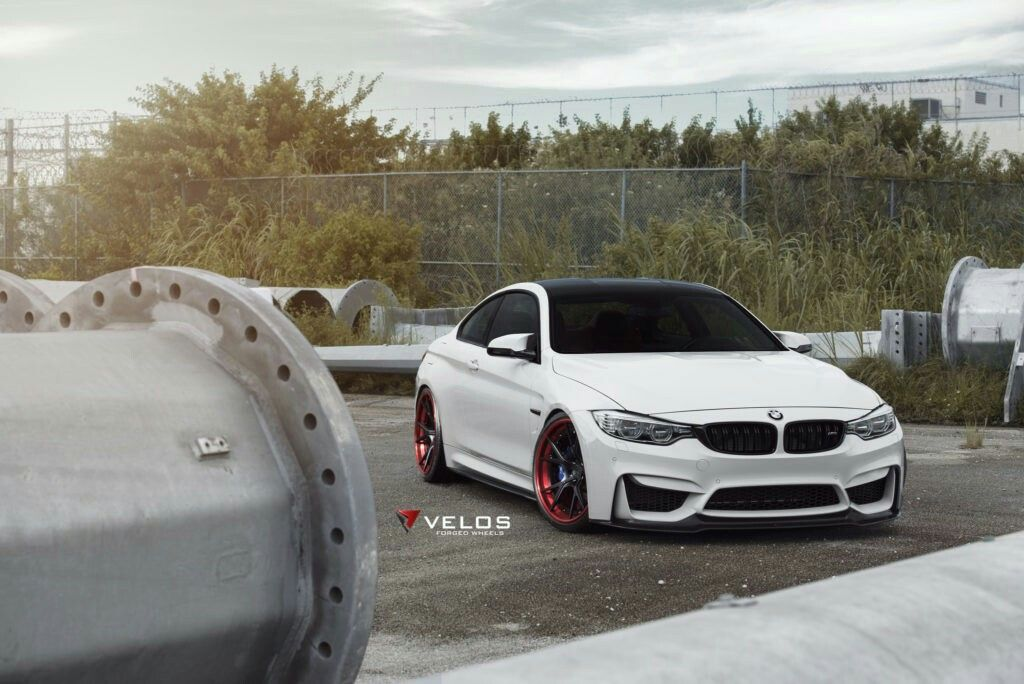 Alpine White BMW F82 M4 With Red Accented Velos wheels