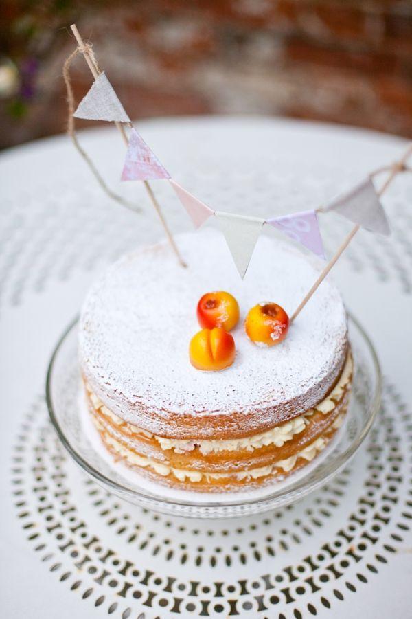 naked Victoria sponge cake with mini bunting cake topper #caketopper #weddingcake #spongecake http://www.weddingchicks.com/2013/10/30/vintage-peach-wedding-ideas/