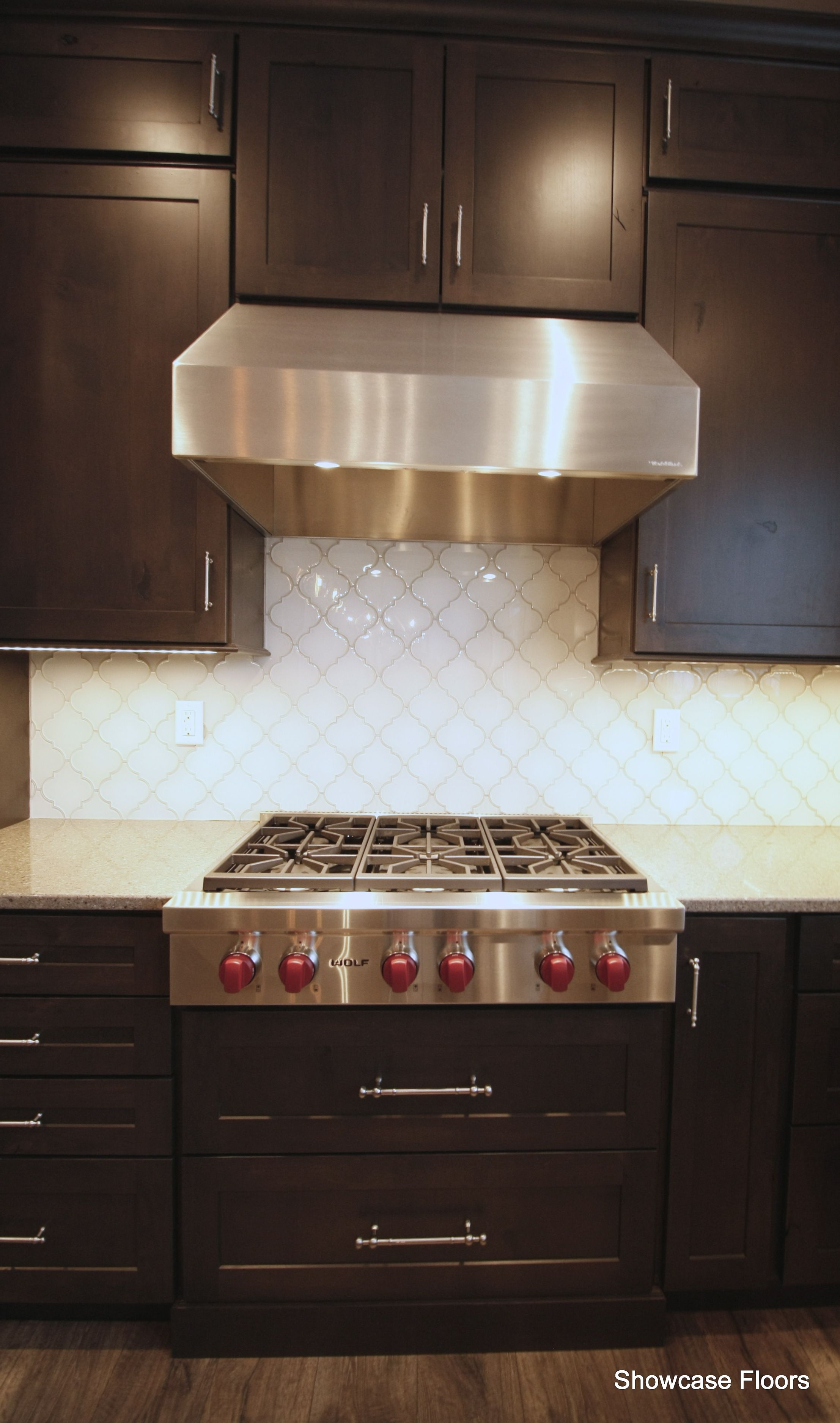 Beautiful Backsplash Tile Against Dark Cabinets And A Wolf Range Showcase Floors Portfolio Kitchen Cabinets Dark Cabinets Wolf Range