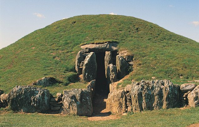 """Bryn Celli Ddu Burial Chamber, Anglesey, Wales. """"Impressive Neolithic chambered tomb, with partially restored entrance passage and mound, on the site of a former henge monument."""