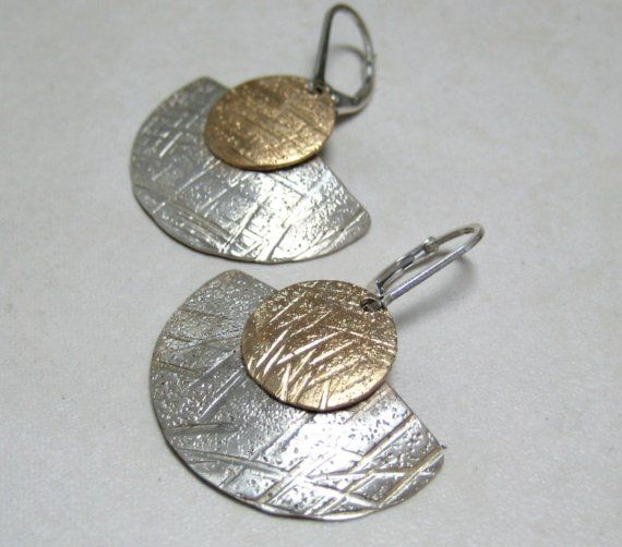 These sterling fans just sort of happened! Made from 1 1/4 sterling discs that I had cut and textured, I decided to play with the design and this was the end result. The sterling brass disc with same design is soldered to the fan and is finished with a sterling leverback wire. The overall length is 1 14/ inches. These earrings are truly stunning on and they combine well with silver or gold.