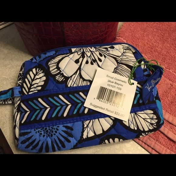 Vera Bradley Makeup Bag NWT VB Small Makeup Bag.  There is a small flaw in the pattern shown on lady page.  Purchased on Posh. Vera Bradley Bags Cosmetic Bags & Cases