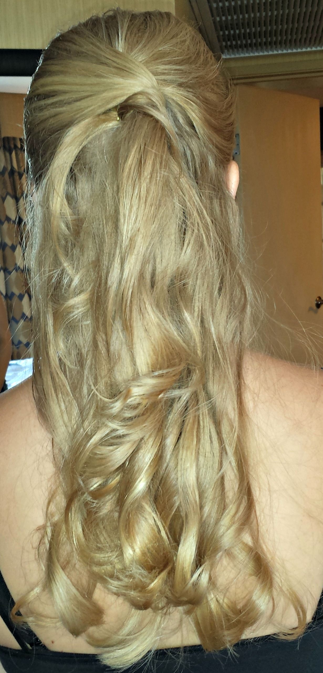 Wedding half up half down hairstyle for the bride twist the pieces