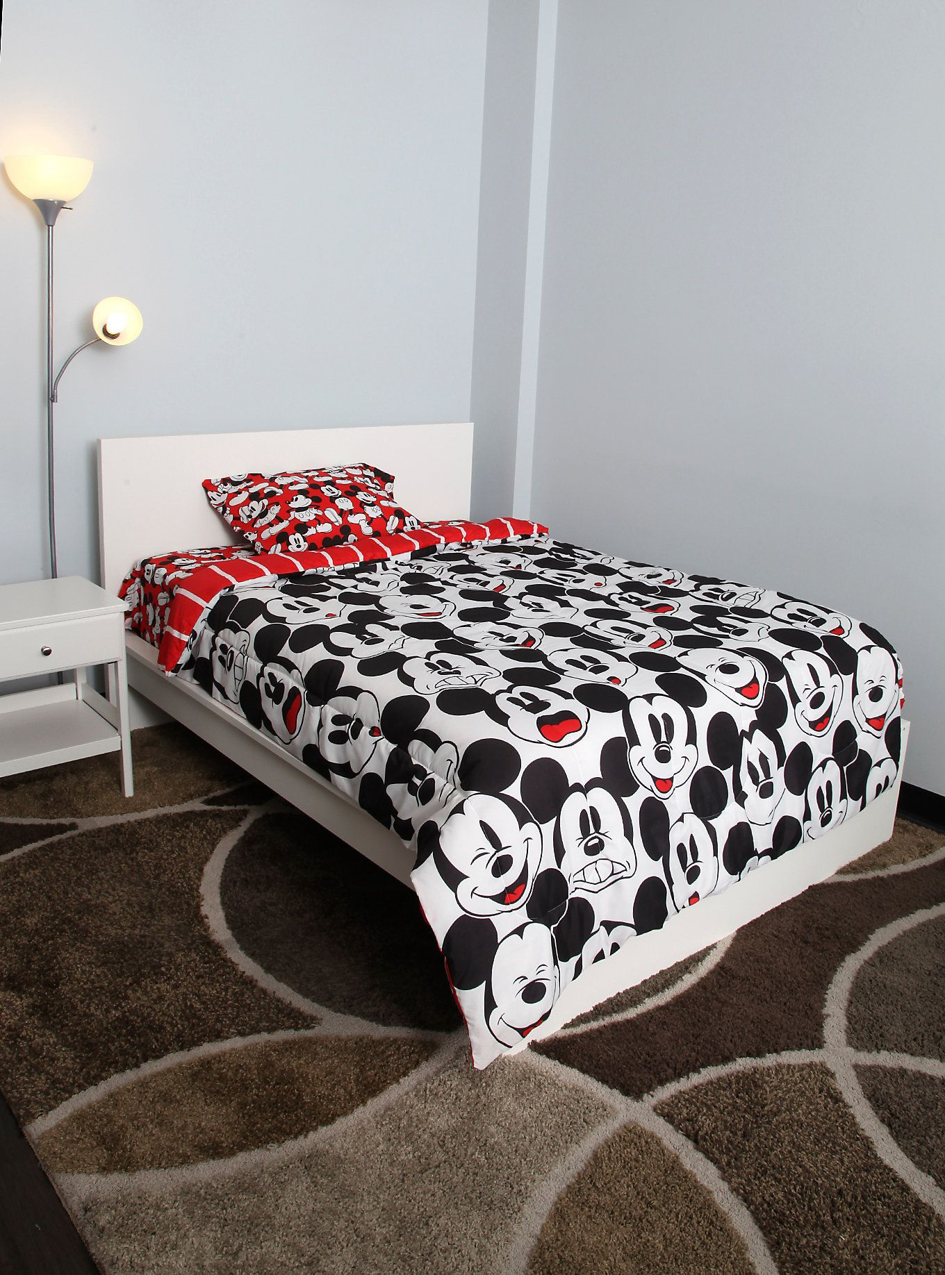 Cover your bed in Mickey and you'll both sleep happy. (via Hot Topic)