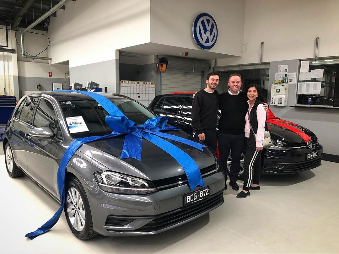Congratulations Young Happy Couple Picking Up Their New Golf S