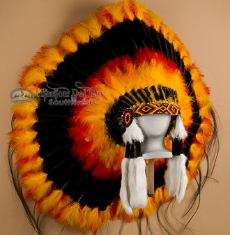 This beautifully hand crated pow wow ceremonial headdress is the perfect focal piece for any Native American or southwestern decor.