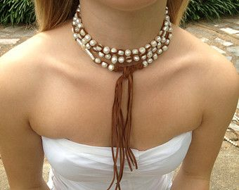 Feminine and beautiful leather and pearl lariat with pearl cross
