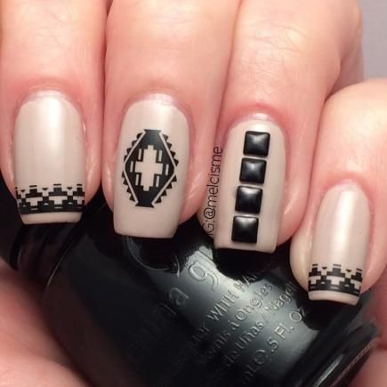 Turn this summer's tribal manicure into a fall nail look with clean lines and demure colors. Love the stud details! #nails #fall