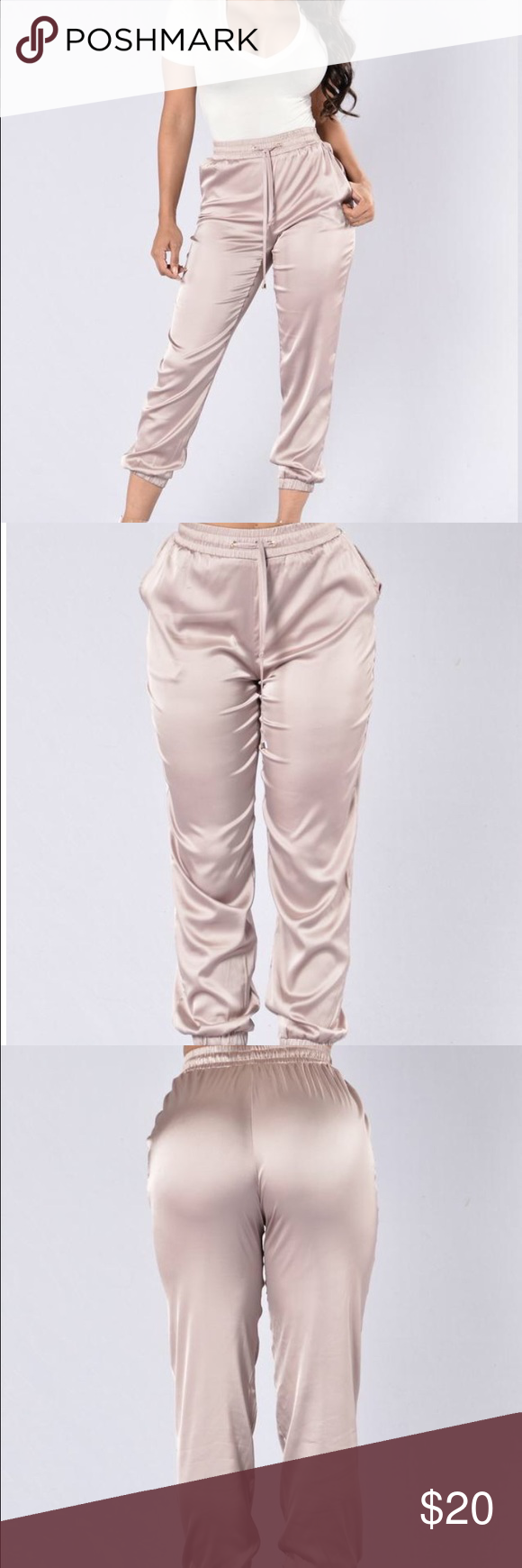 BRAND NEW Genie In A Bottle Pants - Champagne BRAND NEW Genie In A Bottle Pants - Champagne - Medium Satin Jogger Pants Side Pockets Elastic Waist Band with Drawstring Elastic Band Ankle 92% Polyester 8% Spandex Fashion Nova Pants Track Pants & Joggers