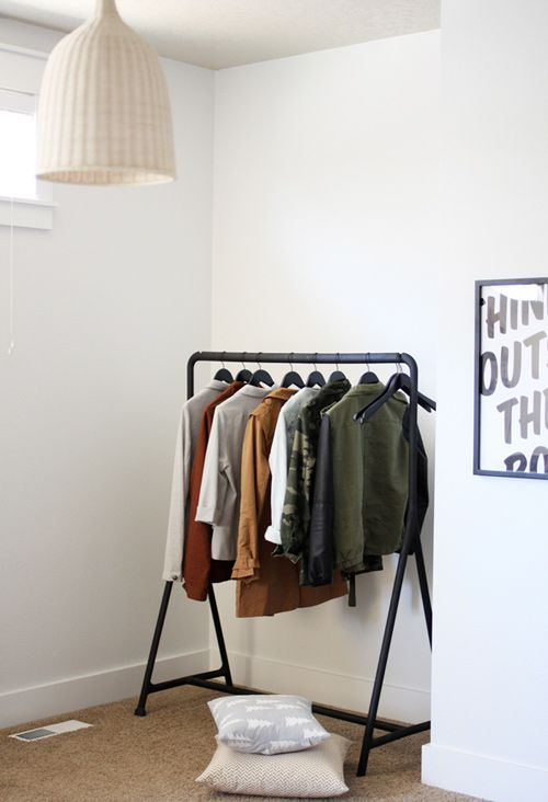 Black clothing rack from Ikea. Simple and stylish - via Remodelista
