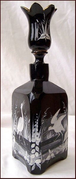 triangular Black Hyalith or Lithyalin Glass perfume bottle… hand enamaled with scenes of waterbirds