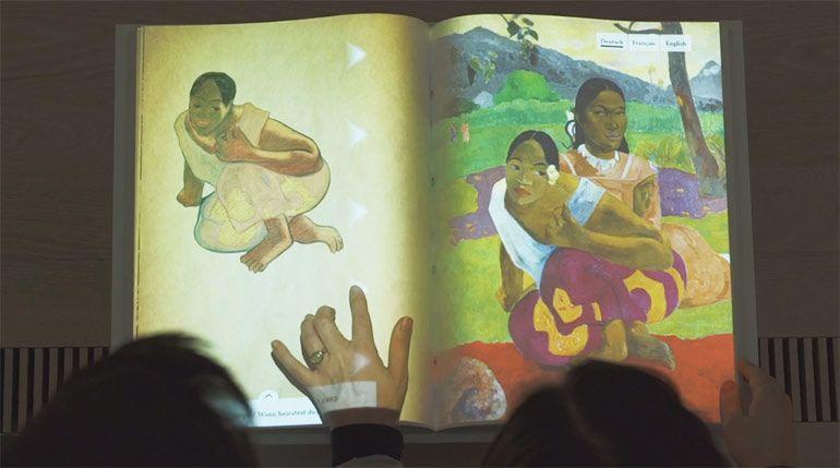Kombination aus Realität und Virtualität: interaktives Buch der Paul Gauguin Ausstellung