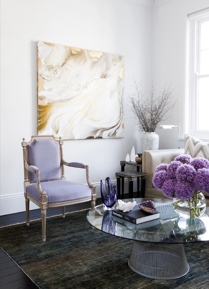 Chic living room with artwork and accents using colors of lilac and ...