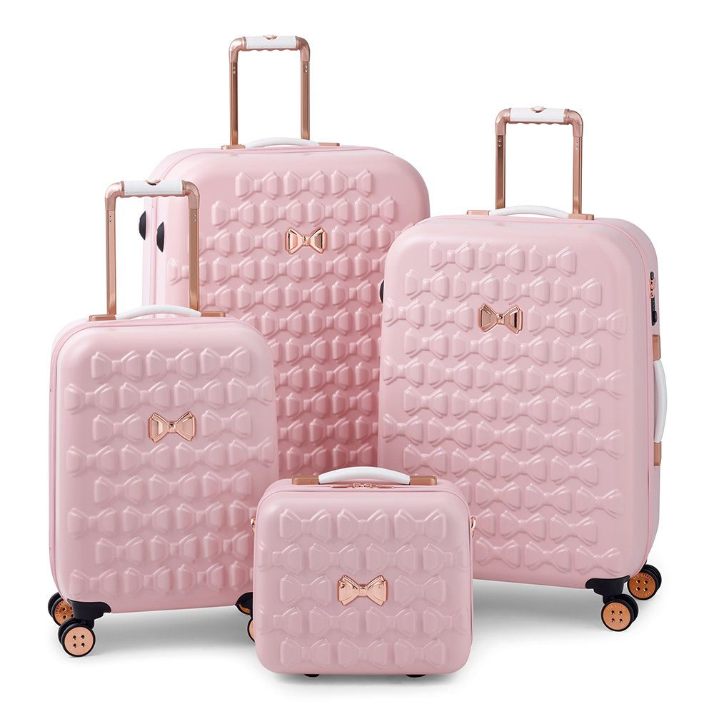 Take off in feminine style with the Moulded Beau suitcase from Ted Baker.  Adorned with moulded bows 72a86e49a7e38
