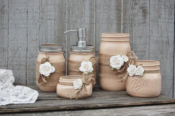 Rustic mason jar bathroom jar set. Hand painted in neutral coffee brown, lightly distressed, wrapped in burlap, tied with jute and cream colored roses, finished